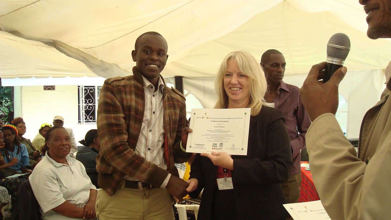 Melanie-Boyd-from-Canadian-High-Commision-presents-a-certificate-to-George-Mugo